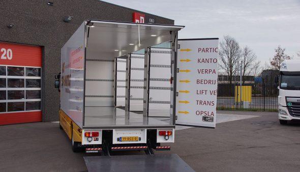 Speciale carrosserie opbouw met maatwerk oplossingen voor verhuisbedrijf - opgebouwd op Renault