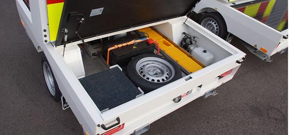 Handige opbergcompartimenten voor Andreastrippen, reservewiel en stempelplaten
