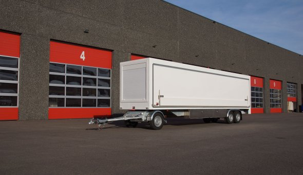 Custom built box van trailer with movers and hydraulic sides from plywood