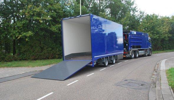 Custom made trailer body as transporter for heavy duty vehicles