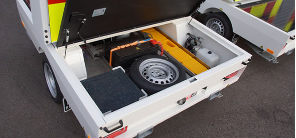Handy storage compartment to store the portable rumble stripes, cones and spare wheel