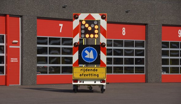 Traffic warning trailer with flashing LED arrow for a better visibility
